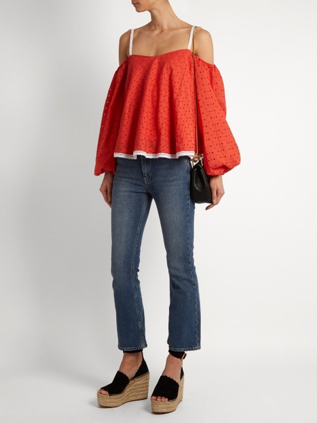 Anna October's penchant for ultra-feminine silhouettes rings true with this red off-the-shoulder top. It's crafted from broderie-anglaise cotton to a voluminous shape with long sleeves and is prettily detailed with white embroidered lace at the skinny s