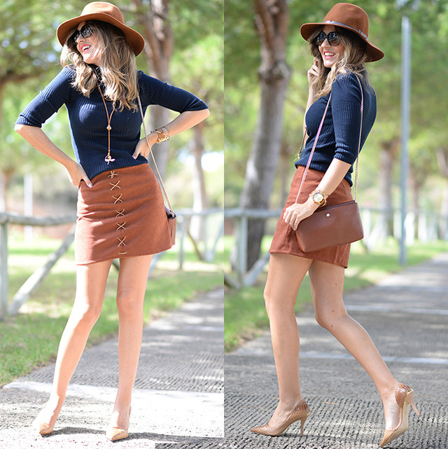 Bicolor look in brown tones and navy blue, with a suede skirt and hat.